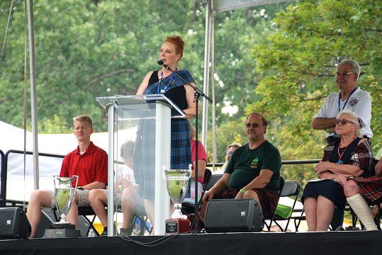 Emma Velasco at the podium at the Opening Ceremony.